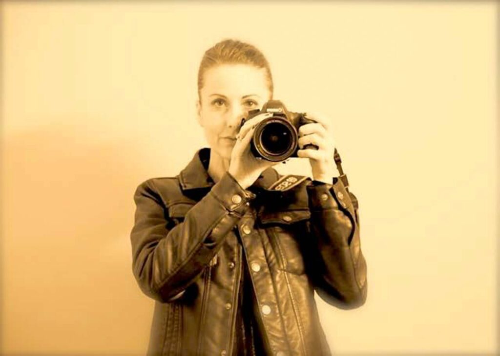 cass louise self portrait with her camera in sepia