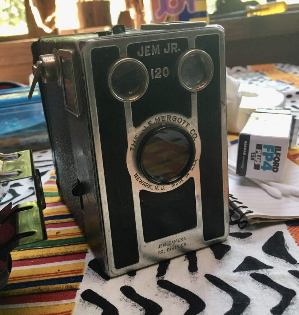 Jem Jr. 120 box Camera with Ilford FP4 Plus 120 film on table
